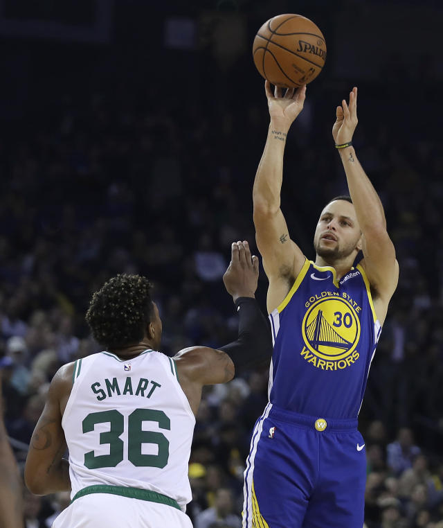 Golden State Warriors' Stephen Curry shoots over Boston Celtics' Marcus Smart (36) during the first half of an NBA basketball game Tuesday, March 5, 2019, in Oakland, Calif. (AP Photo/Ben Margot)