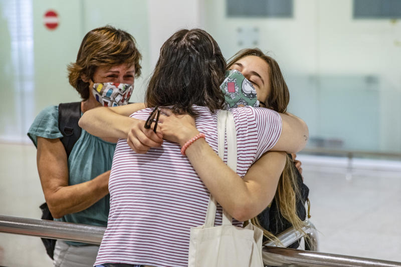 Marta a Mallorcan women that lives in Barcelona hugging to his mother Maite and his sister Teresa whom travels from Mallorca after more than 5 months without see each other due to the pandemic covid19 at Barcelona el Prat airport during reopen to European and Schengen area tourists. Also alllows free movement of Spain citicens after the state of alarm finished on 21 of June after 98 days of restriction of population movement inside Spain territory. In Barcelona el Prat airport on June 22, 2020 in Barcelona, Spain. (Photo by Xavier Bonilla/NurPhoto via Getty Images)