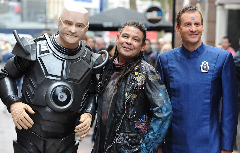 [L-R] Robert Llewellyn as Kryten, Craig Charles as Dave Lister and Chris Barrie as Arnold Rimmer attend a photocall for the return of Red Dwarf, 2012. (Photo by Ferdaus Shamim/WireImage)