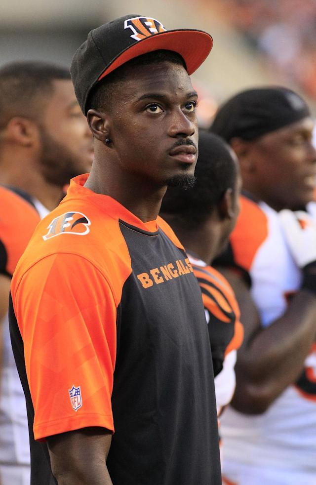 Cincinnati Bengals wide receiver A.J. Green watches from the sidelines in the first half of an NFL preseason football game against the Tennessee Titans, Saturday, Aug. 17, 2013, in Cincinnati. Green has just returned to practice after suffering a bone bruise the first day of training camp. (AP Photo/Tom Uhlman)