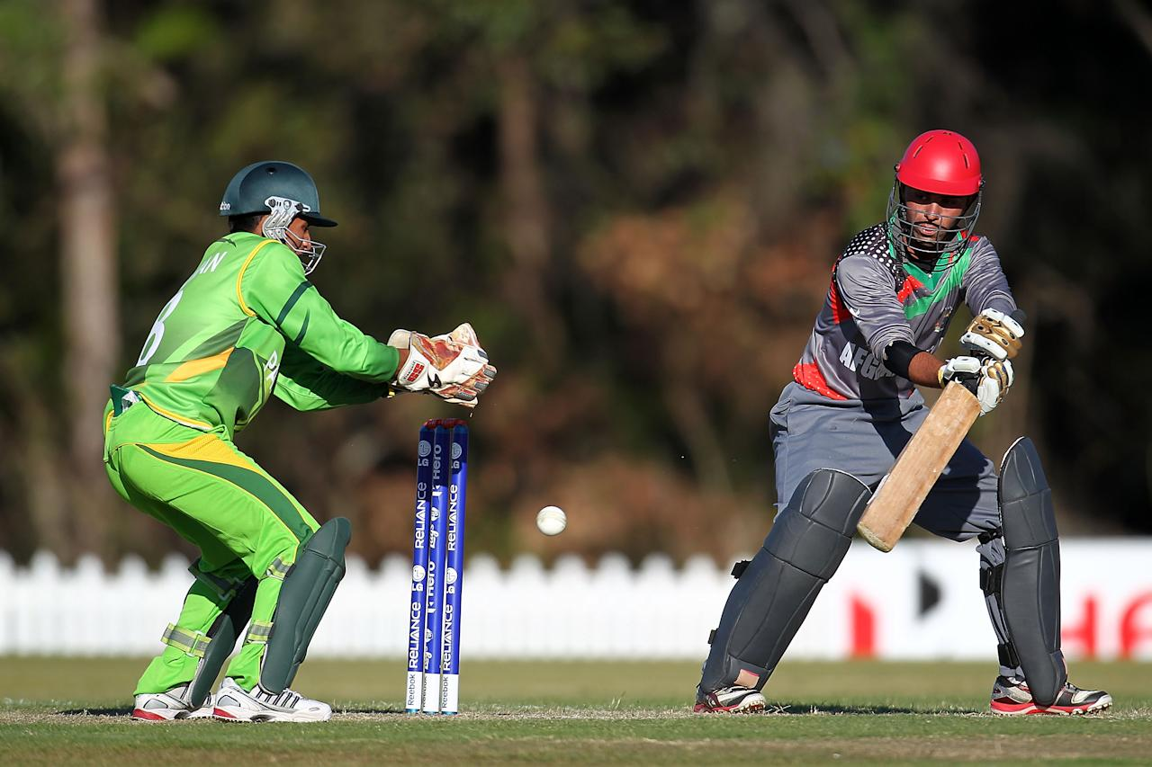 SUNSHINE COAST, AUSTRALIA - AUGUST 11:  Nasir Jamal of Afghanistan (R) bats during the ICC U19 Cricket World Cup 2012 match between Pakistan and Afghanistan at John Blanck Oval on August 11, 2012 in Sunshine Coast, Australia.  (Photo by Graham Denholm-ICC/Getty Images)