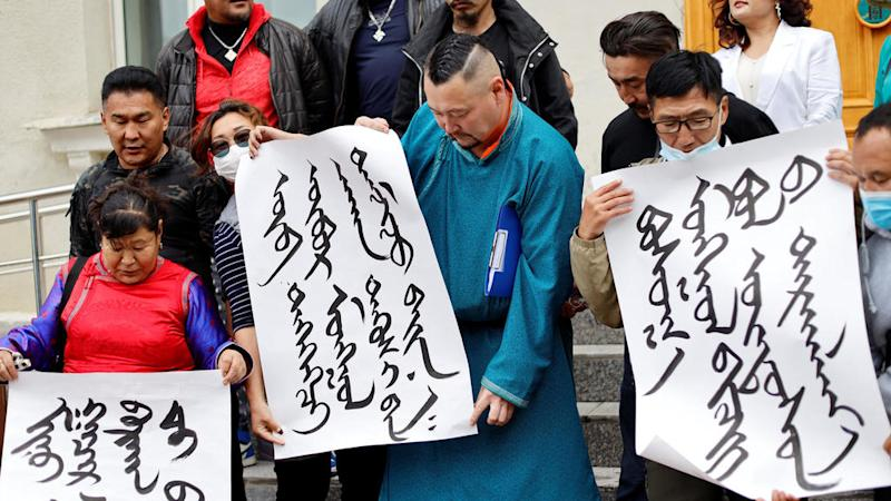 Chinese minorities fear Beijing's efforts to crush local languages, cultures