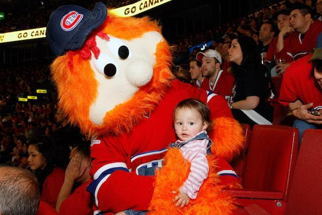 """MONTREAL- MAY 12: Youppi, the <a class=""""link rapid-noclick-resp"""" href=""""/nhl/teams/mon/"""" data-ylk=""""slk:Montreal Canadiens"""">Montreal Canadiens</a> mascot holds a young fan during Game Seven of the Eastern Conference Semifinals between the Montreal Canadiens and the <a class=""""link rapid-noclick-resp"""" href=""""/nhl/teams/pit/"""" data-ylk=""""slk:Pittsburgh Penguins"""">Pittsburgh Penguins</a> during the 2010 NHL Stanley Cup Playoffs at the Bell Centre on May 12, 2010 in Montreal, Quebec, Canada. (Photo by Richard Wolowicz/Getty Images)"""