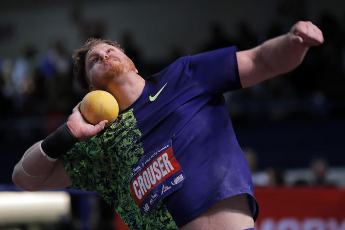 FILE—Ryan Crouser competes during the Men's Shot Put at the Millrose Games track and field meet in this file photograph taken Saturday, Feb. 8, 2020, in New York. Crouser, an OIlympic champion in the shot put, will try to break the world indoor record that he just set last weekend in an event in the American Track League during a session of the league this weekend. (AP Photo/Adam Hunger, File)