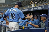 Tampa Bay Rays' Joey Wendle (18) celebrates with manager Kevin Cash after scoring on an RBI single by Kevin Kiermaier off Baltimore Orioles pitcher Jorge Lopez during the first inning of a baseball game Saturday, June 12, 2021, in St. Petersburg, Fla. (AP Photo/Chris O'Meara)