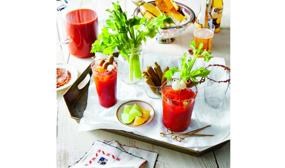 """This image provided by """"Southern Living"""" shows a Bloody Mary bar. (Jennifer Causey/Southern Living via AP)"""
