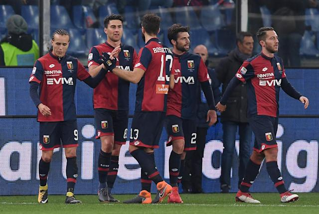 Soccer Football - Serie A - Genoa vs Inter Milan - Stadio Comunale Luigi Ferraris, Genoa, Italy - February 17, 2018 Genoa players celebrate after Inter Milan's Andrea Ranocchia (not pictured) scored an own goal and the first goal for Genoa REUTERS/Alberto Lingria