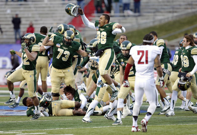Colorado State players celebrate their win after the NCAA New Mexico Bowl college football game against Washington State, Saturday, Dec. 21, 2013, in Albuquerque, N.M. Colorado State won 48-45.(AP Photo/Matt York)