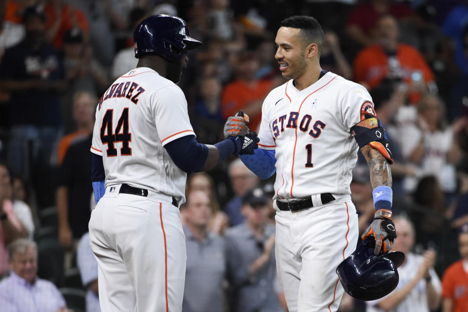 Houston Astros' Carlos Correa (1) celebrates his solo home run with Yordan Alvarez during the fourth inning of a baseball game against the Chicago White Sox, Sunday, June 20, 2021, in Houston. (AP Photo/Eric Christian Smith)