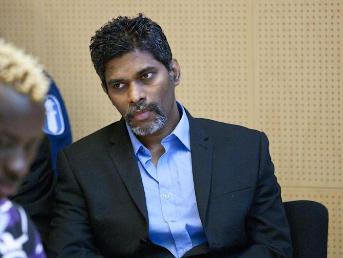 FILE- Singaporean Wilson Maj Perumal sits in the Lapland district court on match fixing charges in Rovaniemi, Finland, in this file photo dated Thursday June 9, 2011. Soccer is falling under a cloud of suspicion as never before, sullied by a multibillion-dollar web of match-fixing that is staining increasingly larger parts of the world's most popular sport. In Finland, eight African players with ties to a Singapore crime gang were banned in 2012 for match-fixing. Their handler, Wilson Raj Perumal, was convicted of fixing games in Finland and is being investigated for allegedly fixing other matches in Europe and Africa. (AP Photo/Lehtikuva, Kaisa Siren, FILE) FINLAND OUT