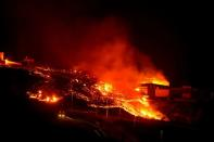 Lava burns buildings following the eruption of the Cumbre Vieja volcano, in Tacande