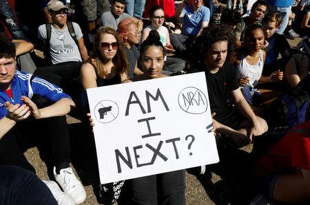 Students who walked out of their Montgomery County, Maryland, schools protest against gun violence in front of the White House in Washington. REUTERS/Kevin Lamarque