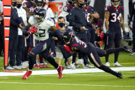Tennessee Titans running back Derrick Henry (22) breaks away from Houston Texans safety A.J. Moore Jr. (33) during the second half of an NFL football game Sunday, Jan. 3, 2021, in Houston. (AP Photo/Sam Craft)