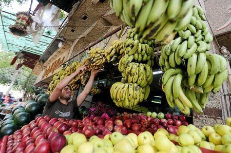 An Egyptian fruits seller is seen at a market in Cairo