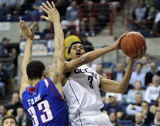 Connecticut's Jeremy Lamb, right, drives past DePaul's Krys Faber during the first half of an NCAA college basketball game in Hartford, Conn., on Wednesday, Feb. 15, 2012. (AP Photo/Fred Beckham)