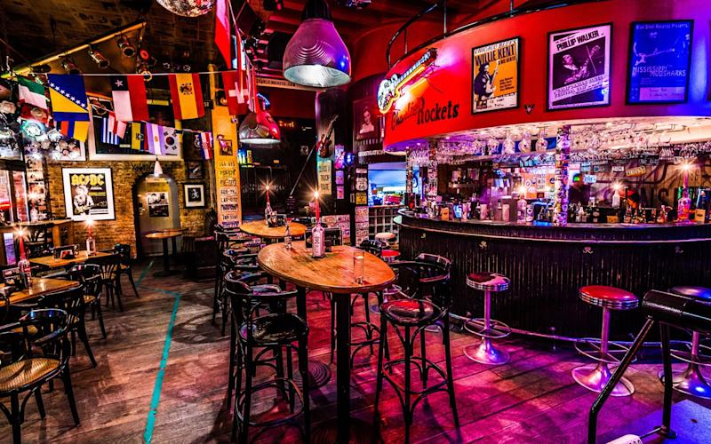 The bar at Charlie Rockets is the dominant feature, open all day and throbbing with classic rock music - Maarten Geukens