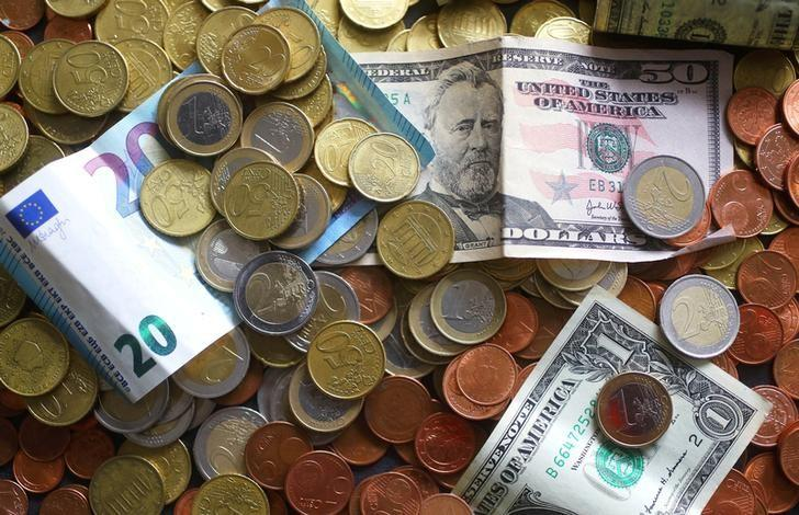 An illustration picture shows euro and US dollar banknotes and coins