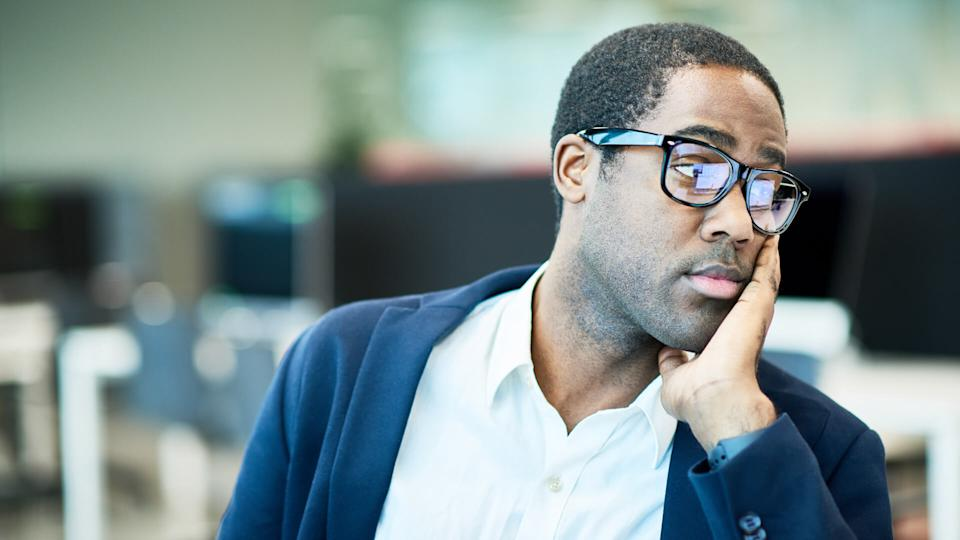 businessman looking at monitor in office