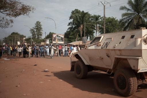 Residents of a Muslim district in Bangui protest on April 11 in front of the UN mission base. They laid out the bodies of 17 men who they claimed were killed by Blue Helmets