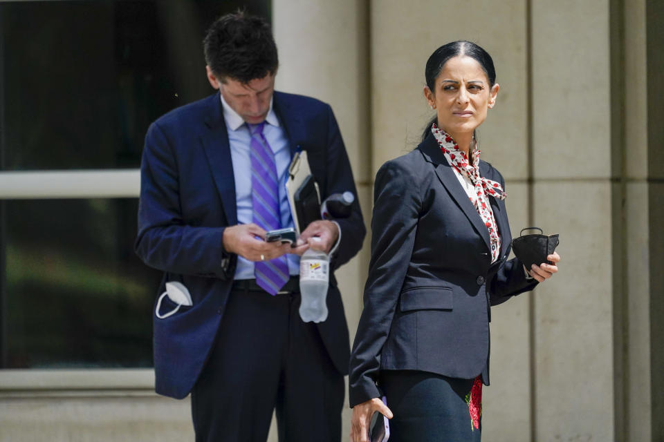 R. Kelly's attorneys Nicole Becker, right, and Thomas Farinella step outside Brooklyn Federal court during a lunch break in R&B star's trial, Thursday, Aug. 19, 2021, in New York. (AP Photo/Mary Altaffer)