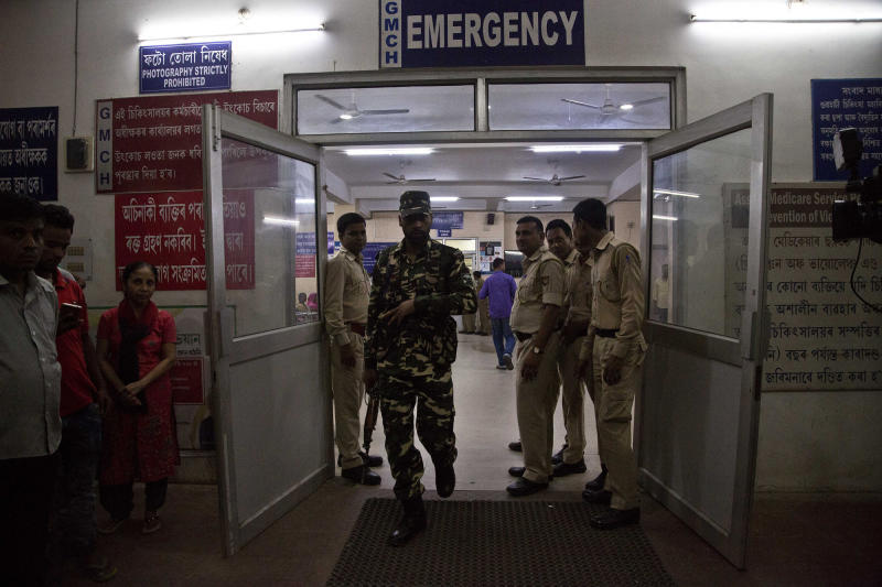 Security personnel stand guard outside medical college hospital where people injured in a grenade attack are treated in Gauhati, India, Wednesday, May 15, 2019. (AP Photo/Anupam Nath)