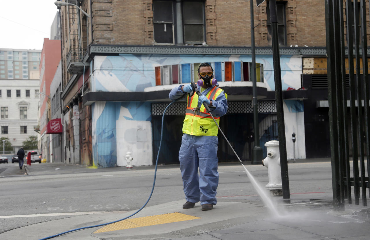 Eighi Hiastake, of the San Francisco Dept. of Public Works, washes a city sidewalk with a mixture of water and detergent on Tuesday, July 15, 2014, in San Francisco. In one of the most drastic responses yet to California's drought, state regulators on Tuesday will consider fines of up to $500 a day for people who waste water on landscaping, fountains, washing vehicles and other outdoor uses. The rules would prohibit watering of landscaping to the point that runoff spills onto sidewalks or streets. Hosing down sidewalks, driveways and other hard surfaces would be prohibited, as would washing vehicles without a shut-off nozzle. (AP Photo/Marcio Jose Sanchez)