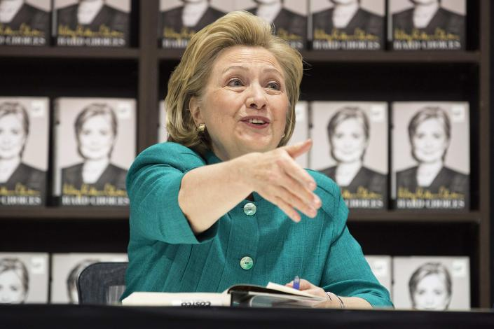 """Former U.S. Secretary of State Hillary Clinton greets people as she signs copies of her book """"Hard Choices"""" at a Costco store in Arlington, Virginia in this file photo from June 14, 2014. New Jersey voters favor former Secretary of State Hillary Clinton over their own Governor Chris Christie in the 2016 U.S. presidential race, according to poll results released August 6, 2014. REUTERS/Joshua Roberts/Files (UNITED STATES - Tags: POLITICS MEDIA)"""