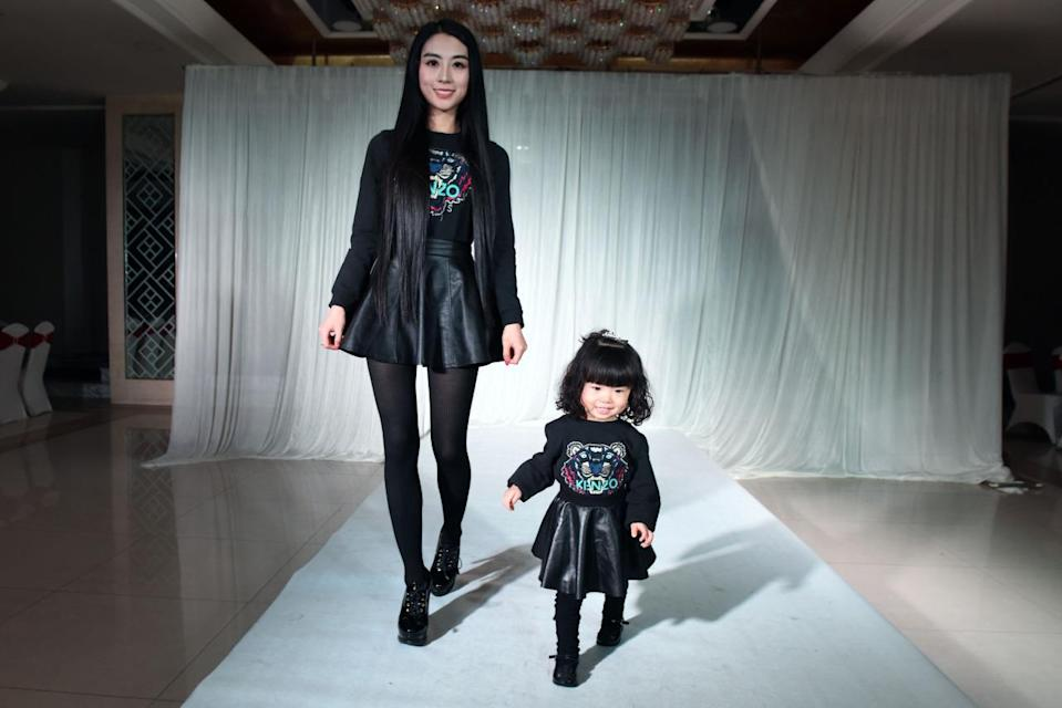 For the duo's edgiest look of the show, they chose to wear black Kenzo sweatshirts with leather circle skirts.