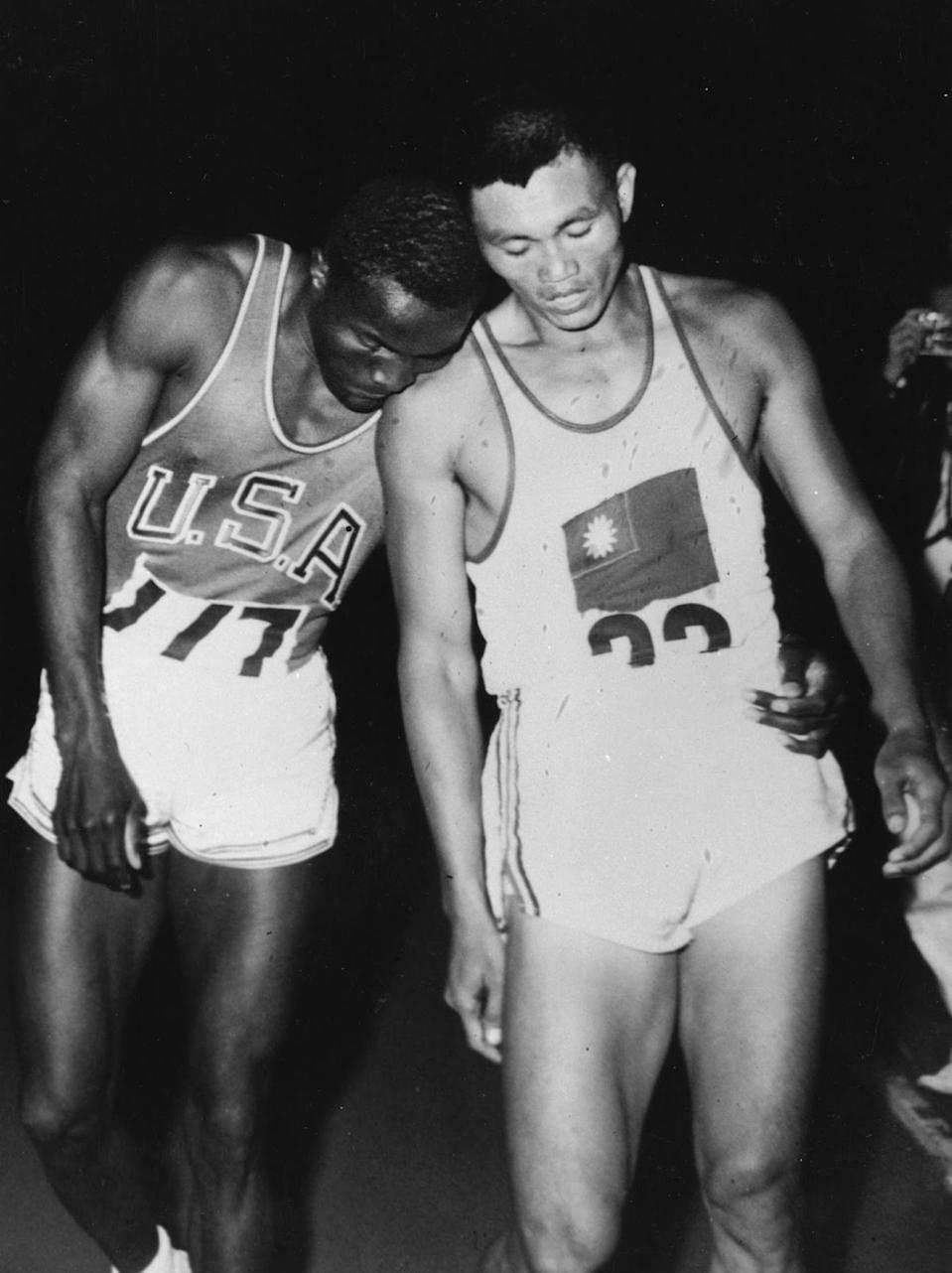 American athlete Rafer Johnson (left) and Yang Chuan-kwang of Taiwan together after completing the 1500m event of the decathlon at the 1960 Rome Olympics. Johnson went on to win the decathlon with Yang in second place. (PHOTO: Keystone/Getty Images)