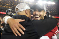San Francisco 49ers quarterback Jimmy Garoppolo, right, celebrates with assistant coach Miles Austin after the NFL NFC Championship football game against the Green Bay Packers Sunday, Jan. 19, 2020, in Santa Clara, Calif. The 49ers won 37-20 to advance to Super Bowl 54 against the Kansas City Chiefs. (AP Photo/Tony Avelar)