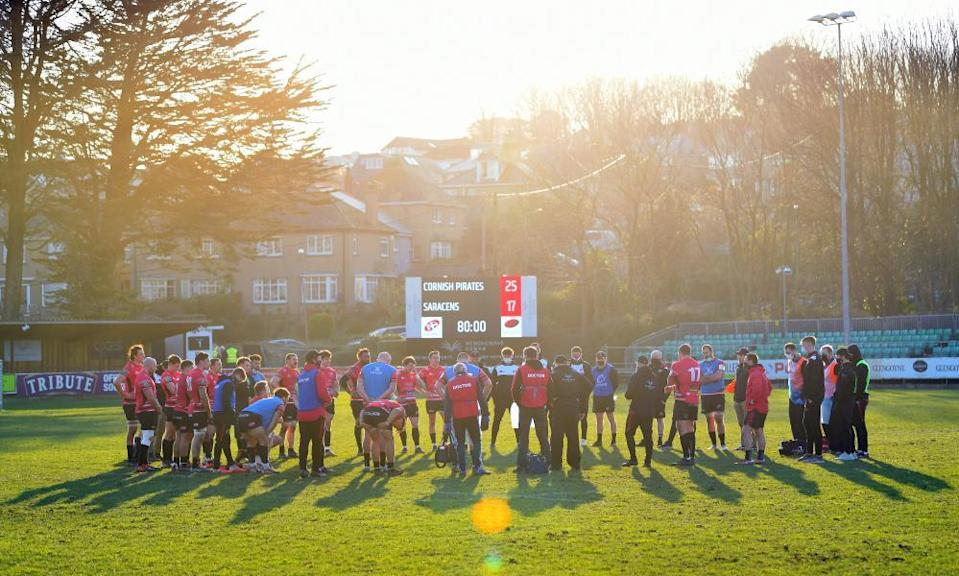 The Cornish Pirates gather to celebrate in the Penzance sun following their victory against Saracens at Mennaye Field.