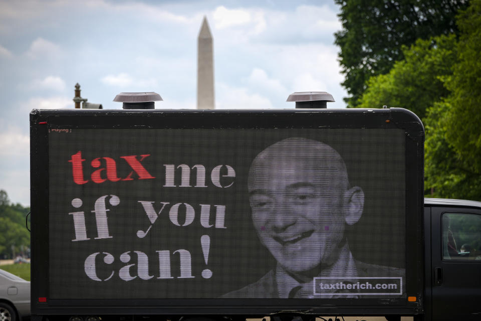 WASHINGTON, DC - MAY 17: A mobile billboard calling for higher taxes on the ultra-wealthy depicts an image of billionaire businessman Jeff Bezos, near the U.S. Capitol on May 17, 2021 in Washington, DC. Organized by the group