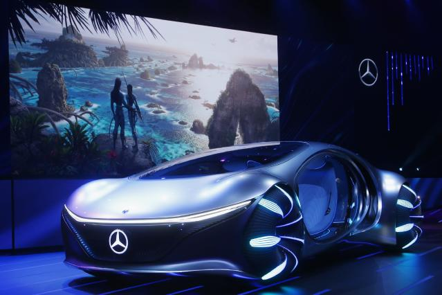 Daimler announces the world premiere of the Mercedes-Benz Vision AVTR concept car at the Daimler Keynote along with a sneak peek of the new Avatar 2 movie, background image, before the CES tech show Monday, Jan. 6, 2020, in Las Vegas. (AP Photo/Ross D. Franklin)