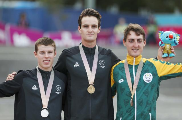 Cycling Cross-Country - Gold Coast 2018 Commonwealth Games - Mountain Bike - Men's Cross-Country - Nerang Mountain Bike Trails - Gold Coast, Australia - April 12, 2018. Gold medallist Samuel Gaze of New Zealand, silver medallist Anton Cooper of New Zealand and bronze medallist Alan Hatherly of South Africa pose with their medals. REUTERS/Paul Childs