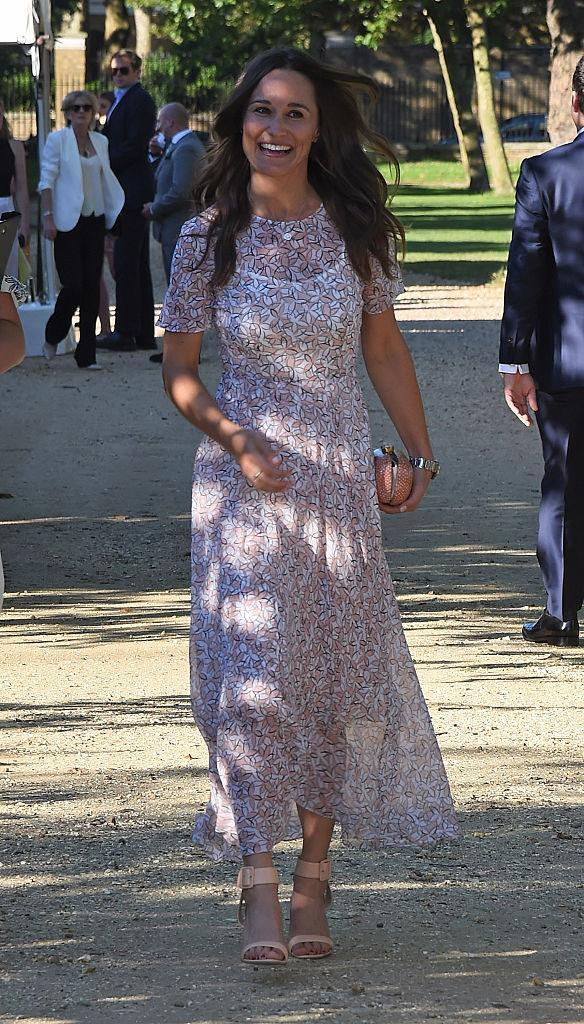 <p>Just a day before officially announcing her engagement, Kate's sister was all smiles in an airy summer dress.<i> (Photo by David M. Benett/Dave Benett/Getty Images for British Heart Foundation)</i><br></p>