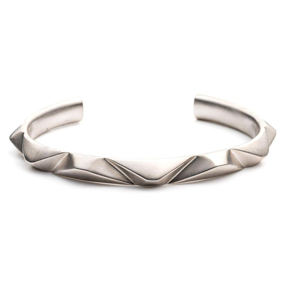 """<p><strong>PRIZM</strong></p><p>thirdcrown.com</p><p><strong>$200.00</strong></p><p><a href=""""https://www.thirdcrown.com/collections/all-bracelets/products/prizm-cuff-antique-silver-plated-brass"""" rel=""""nofollow noopener"""" target=""""_blank"""" data-ylk=""""slk:BUY IT HERE"""" class=""""link rapid-noclick-resp"""">BUY IT HERE</a></p><p>The curved shape of this bracelet is elevated with a modern angled prism detail for a more dynamic and multidimensional interpretation of the traditional cuff.</p>"""