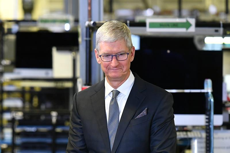 Apple CEO Tim Cook speak to the press during a tour of the Flextronics computer manufacturing facility, with US President Donald Trump, where Apple's Mac Pros are assembled in Austin, Texas, on November 20, 2019. (Photo by MANDEL NGAN / AFP) (Photo by MANDEL NGAN/AFP via Getty Images)