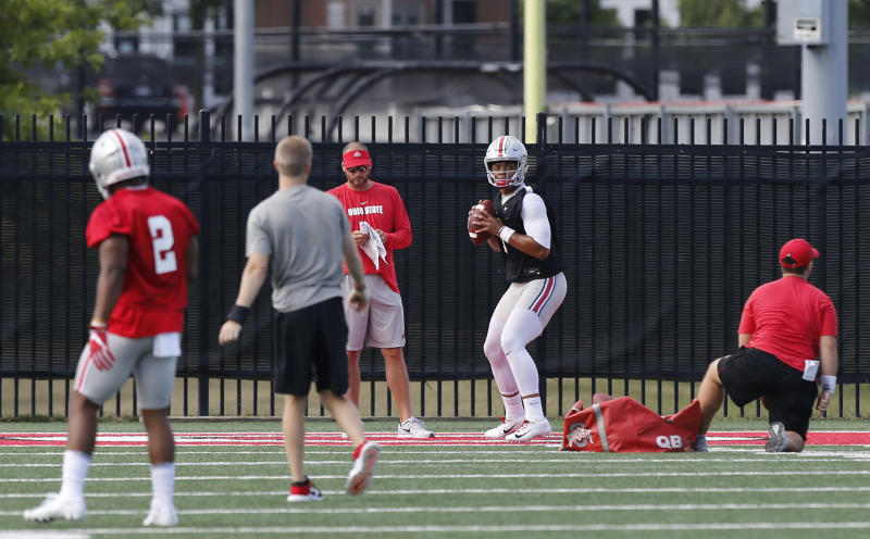 Ohio State quarterback Justin Fields drops back to pass during NCAA college football practice, Friday, Aug. 2, 2019, in Columbus, Ohio. (AP Photo/Jay LaPrete)