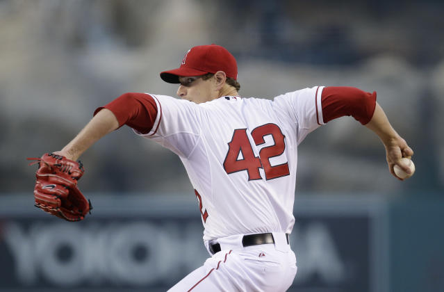 Los Angeles Angels starting pitcher Garrett Richards winds up during the first inning of a baseball game against the Oakland Athletics on Tuesday, April 15, 2014, in Anaheim, Calif. (AP Photo/Jae C. Hong)