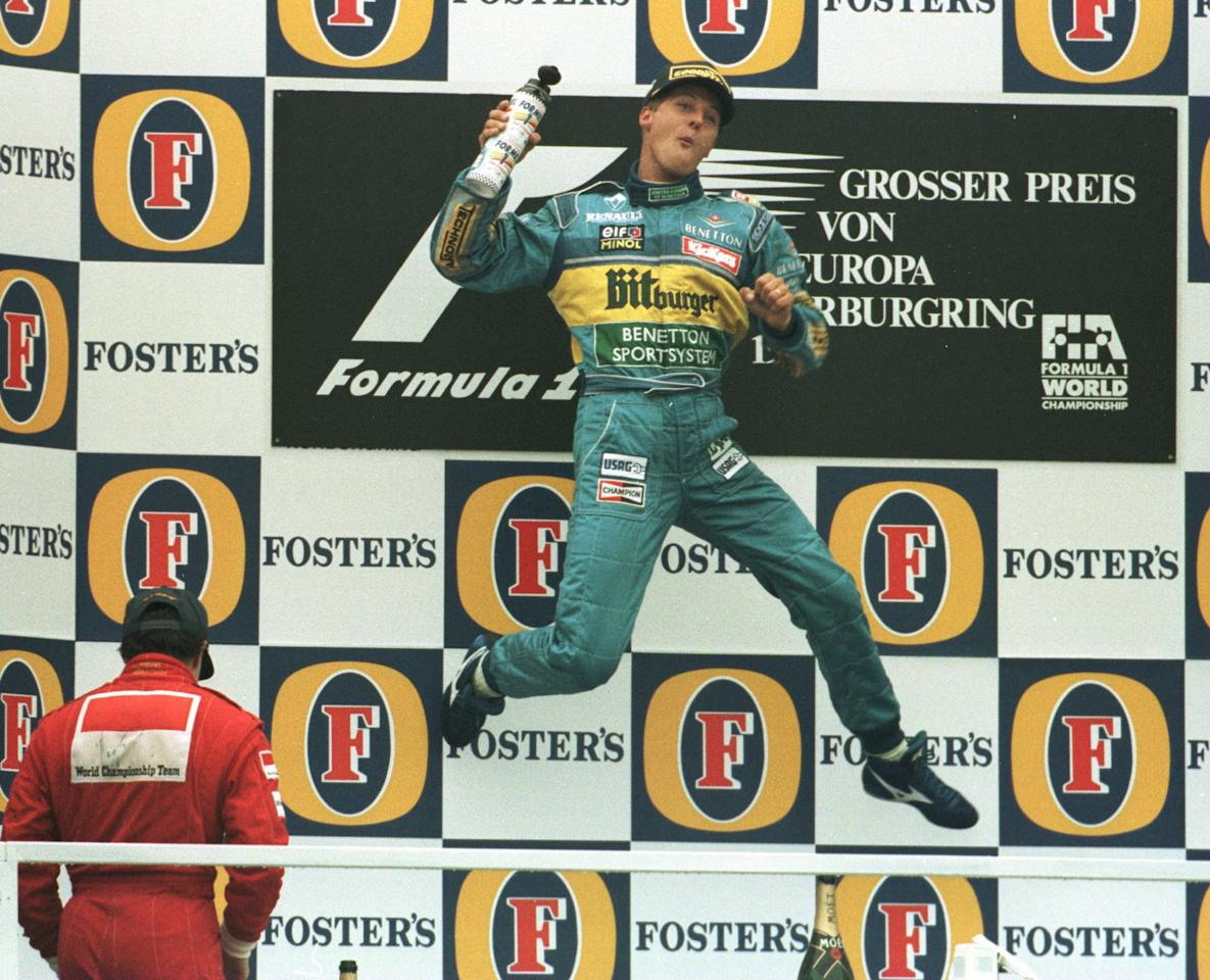 1 OCT 1995:  MICHAEL SCHUMACHER OF GERMANY CLUTCHES THE TROPHY AS HE LEAPS FOR JOY ON THE PODIUM AFTER WINNING THE EUROPEAN GRAND PRIX IN NURBURGRING, GERMANY.  Mandatory Credit: Anton Want/ALLSPORT