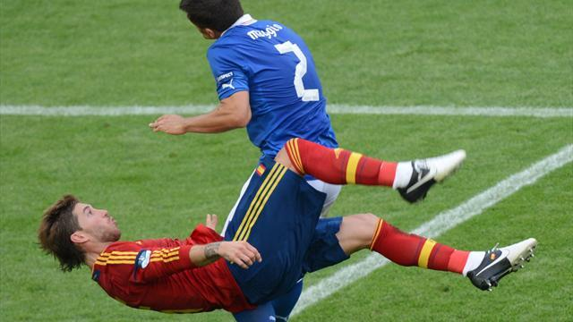 Spanish defender Sergio Ramos (L) vies with Italian defender Christian Maggio during the Euro 2012 championships football match Spain vs Italy on June 10, 2012 at the Gdansk Arena