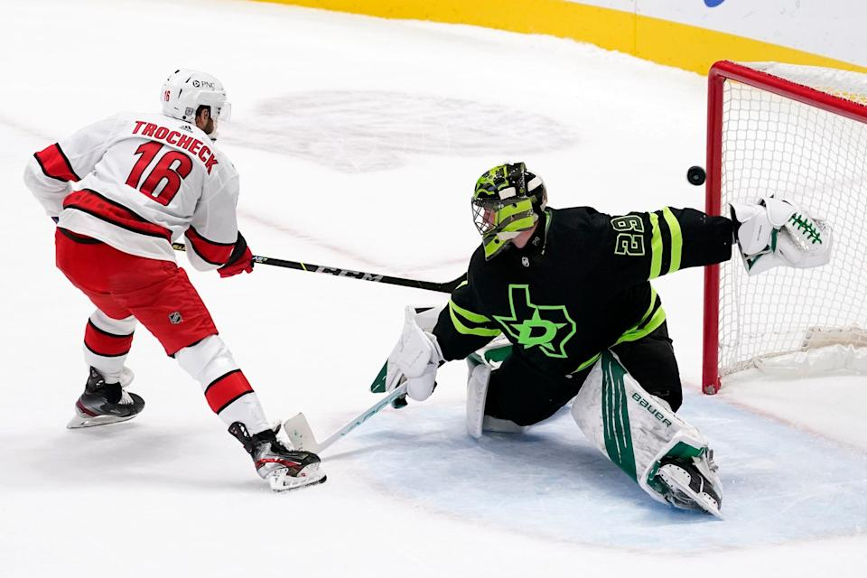 Carolina Hurricanes center Vincent Trocheck (16) scores against Dallas Stars' Jake Oettinger (29) during the shootout in an NHL hockey game in Dallas, Saturday, Feb. 13, 2021. The Hurricanes won 4-3. (AP Photo/Tony Gutierrez)
