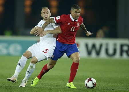 Football Soccer - Georgia v Serbia - World Cup 2018 Qualifiers - Group D - Boris Paichadze Dinamo Arena,Tbilisi, Georgia - 24/3/17. Serbia's Aleksandar Kolarov in action against Georgia's Valerian Gvilia. REUTERS/David Mdzinarishvili