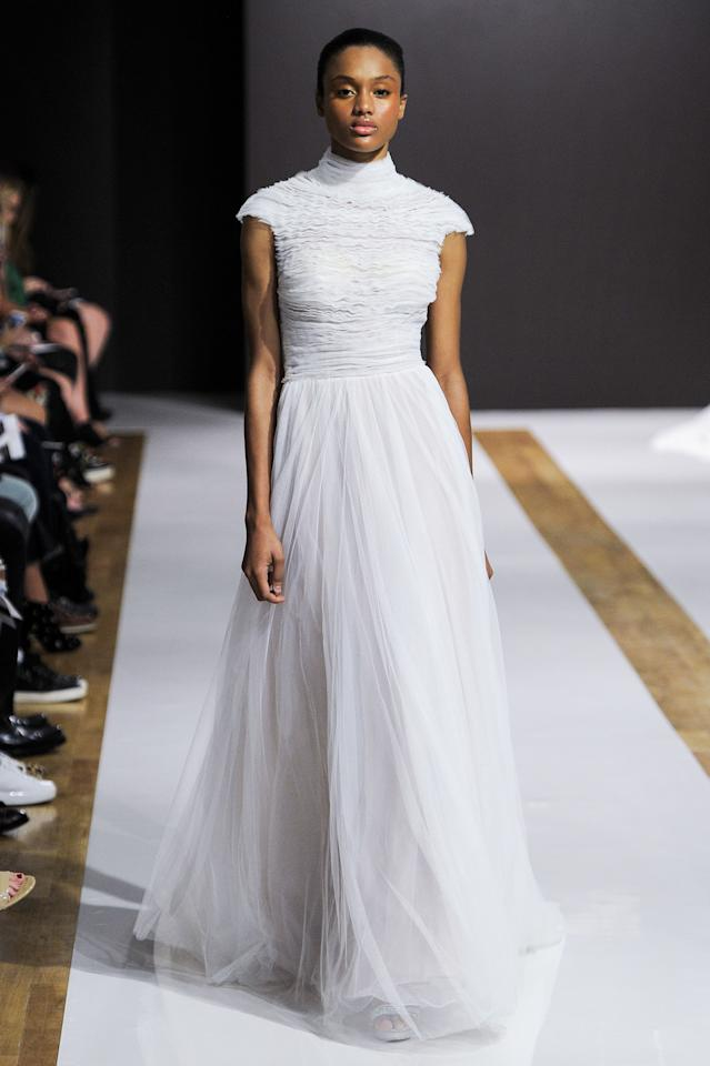 <p>A tulle twist on a style similar to Pippa Middleton says 'covered up but still chic'.</p>