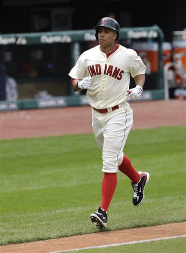 Cleveland Indians' Michael Brantley runs the bases after hitting a solo home run off Detroit Tigers starting pitcher Doug Fister in the sixth inning of a baseball game, Sunday, July 7, 2013, in Cleveland. (AP Photo/Tony Dejak)