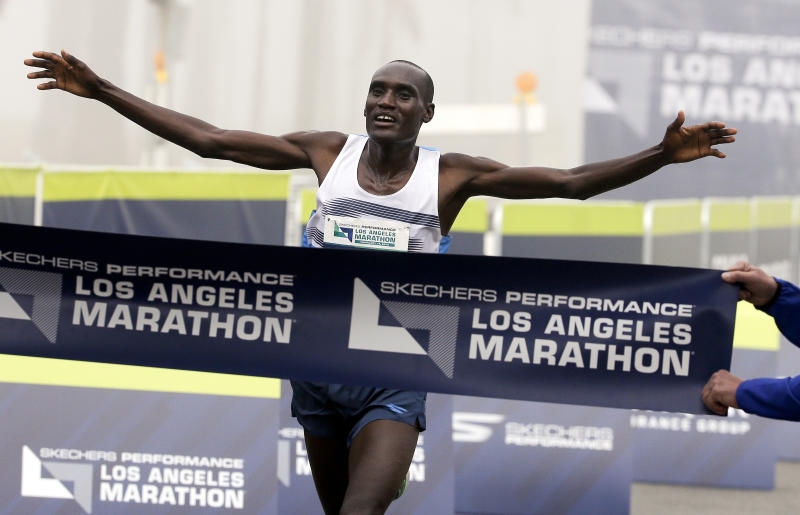 FILE - In this Feb. 14, 2016, file photo, Weldon Kirui celebrates as he wins the Los Angeles Marathon in Santa Monica, Calif. This is the 10th year for the current LA course. The race begins at Dodger Stadium and goes through downtown, Hollywood, Beverly Hills, Century City and Brentwood before ending near the Santa Monica Pier and the Pacific Ocean. (AP Photo/Chris Carlson, File)
