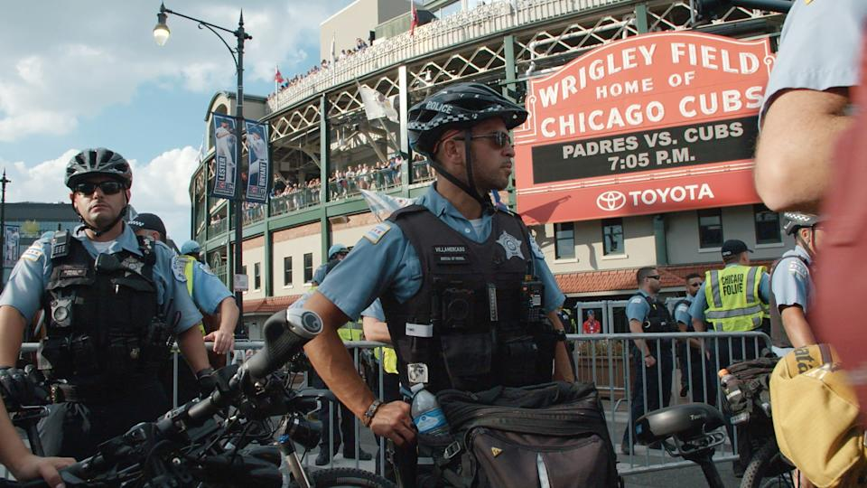 """Police stand outside Chicago's Wrigley Field in Steve James' """"City So Real."""""""