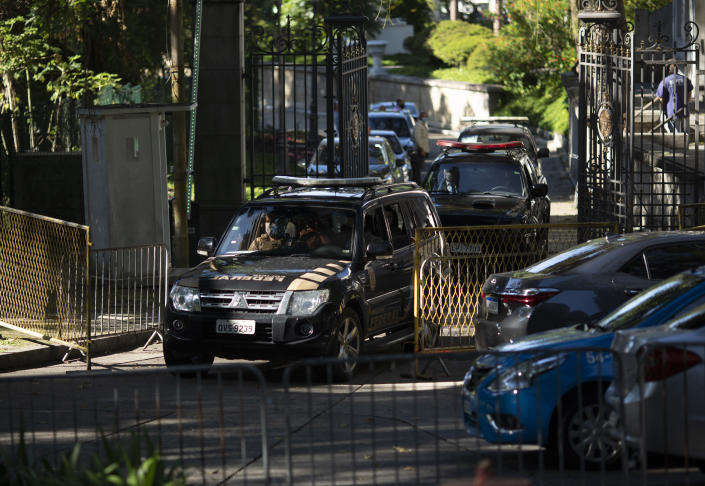 Federal police leave Laranjeiras Palace, the official residence of Rio de Janeiro Gov. Wilson Witzel, in Rio de Janeiro, Brazil, Tuesday, May 26, 2020. Brazil's Federal Police raided the governor's official residence on Tuesday to carry out searches, part of an investigation into the embezzlement of public resources in the state's response to the COVID-19 pandemic. (AP Photo/Silvia Izquierdo)
