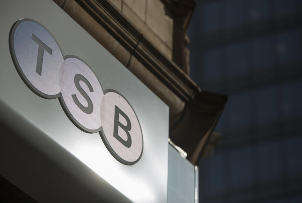 A sign is displayed outside a branch of the TSB bank in central London March 12, 2015. British challenger bank TSB has received a takeover approach from Banco Sabadell, valuing the business at about $2.6 billion and sending its shares soaring by nearly a quarter. REUTERS/Neil Hall (BRITAIN - Tags: BUSINESS)