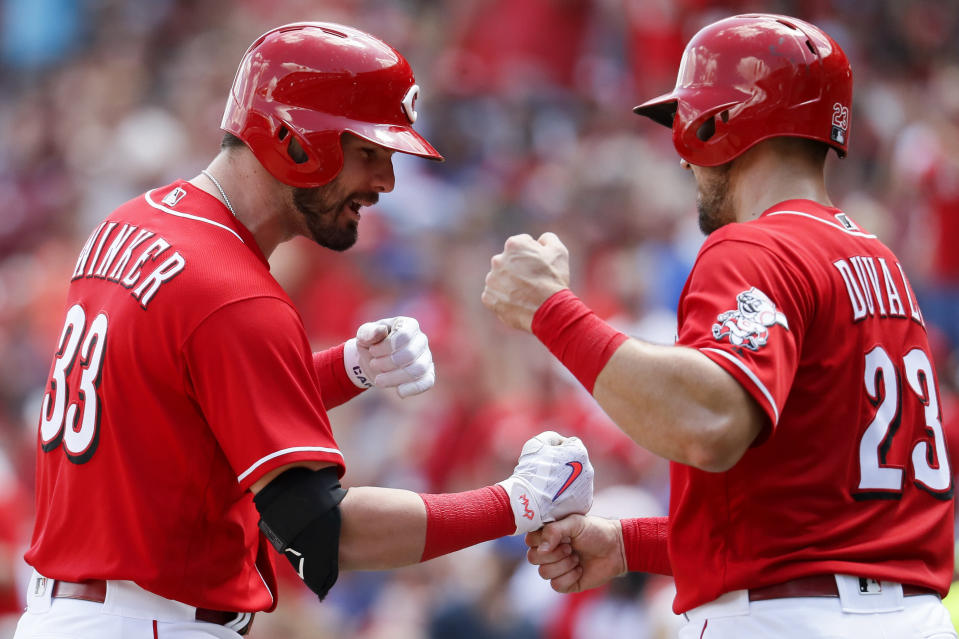 Jesse Winker (left) and Adam Duvall, working on their Rock-Paper-Scissors game (AP/John Minchillo)